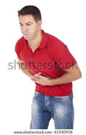 a young man is suffering from abdominal pain - stock photo