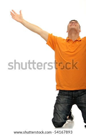 A young man joyously throws his hands up in the air. Includes the clipping path. - stock photo