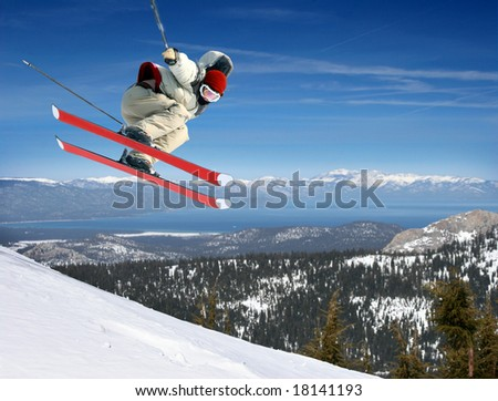 A young man jumping high at Lake Tahoe resort - stock photo