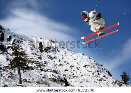 A young man jumping high at Lake Tahoe resort - stock photo