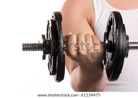 A young man lifting a dumbbell isolated over a white background. - stock photo