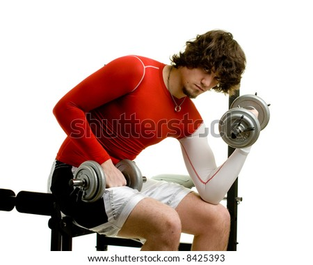 A young man lifting weights over a white background. - stock photo