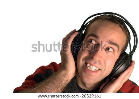 A young man listening to music on a set of headphones, isolated against a white background