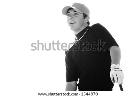 A young man looks of into the distance as he leans on his golf club. - stock photo