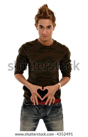 A young man making a heart shape with his fingers