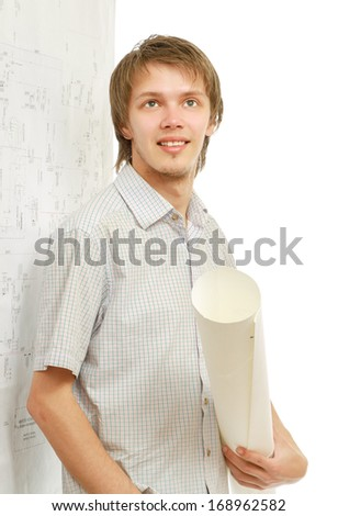 A young man near a diagram, holding a rolled draft - stock photo
