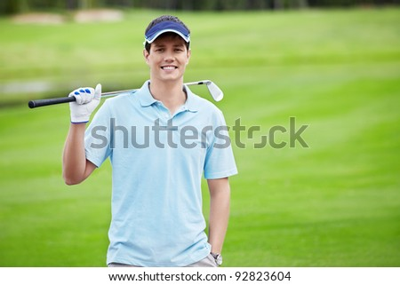 A young man on the golf course - stock photo