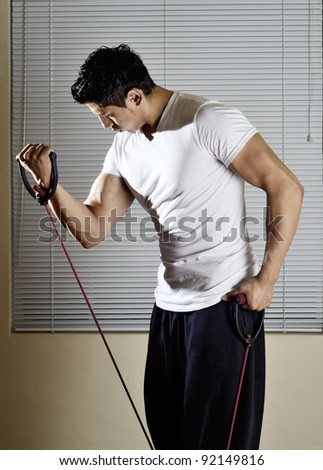 A young man putting his biceps through their paces - stock photo