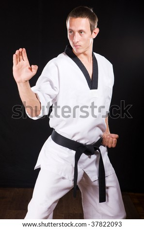 a young man ready to fight on black with clipping path - stock photo