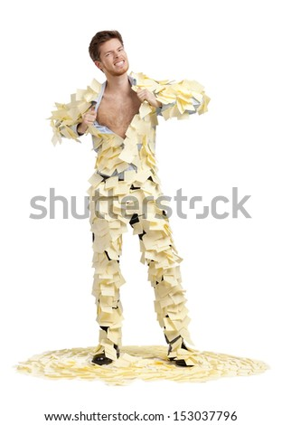 A young man ripping off his shirt, covered with stickers, isolated on white background - stock photo