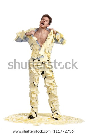 A young man ripping off his shirt, covered with stickers, isolated on white, full-length portrait - stock photo