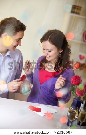 A young man showing engagement ring to his girlfriend - stock photo