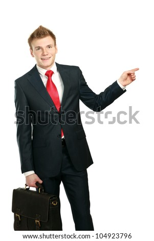 A young man showing something isolated on white background