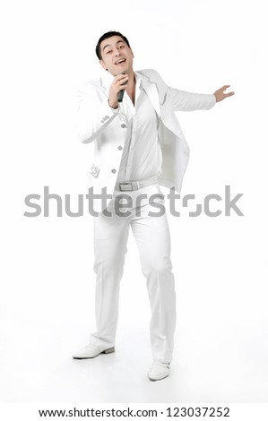 a young man singing into a microphone on a white background - stock photo