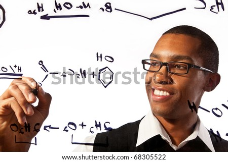 a young man studies a chemistry problem - stock photo