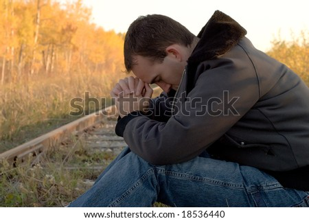A young man suffering from a mood disorder - stock photo