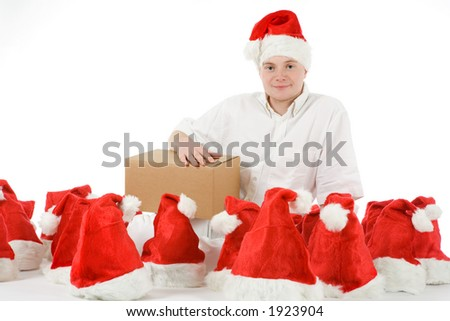 a young man surrounded of many christmas hats