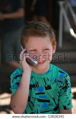 a young man talks on a cell phone - stock photo