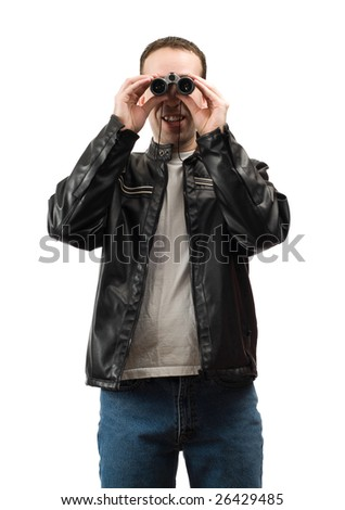 A young man watching something with a set of binoculars, isolated against a white background - stock photo