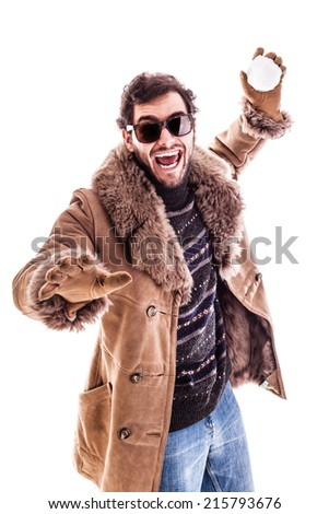 a young man wearing a sheepskin coat isolated over a white background playing with a snowball - stock photo