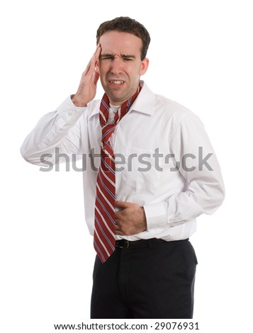 A young man wearing a suit and tie is suffering from a stomach ache and a headache at the same time, isolated against a white background - stock photo