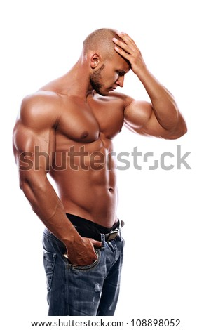 A young man with a beautiful physique thinking on a white background - stock photo