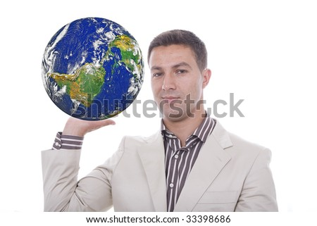 a young man with a globe in his hands - stock photo