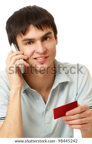 A young man with a mobile phone and a card