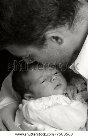 A young man with a newborn girl. Family, love, caring. - stock photo
