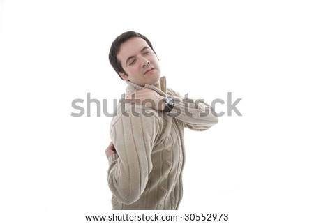 a young man with pain on his shoulder - stock photo