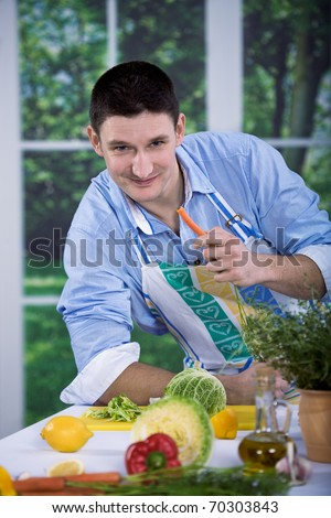 a young man working in the kitchen - stock photo