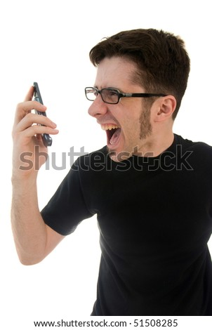 A young man yelling into a cell phone. - stock photo