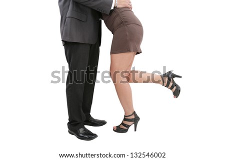 A young manager seducing his secretary or colleague