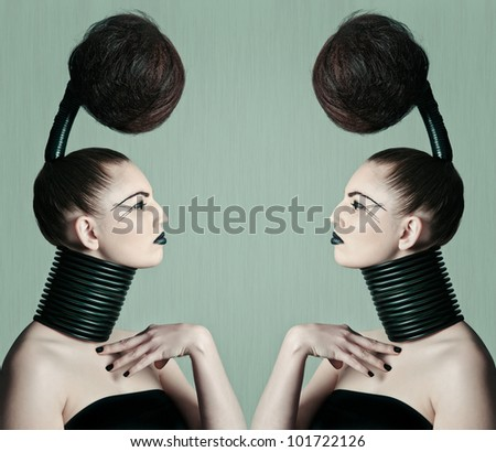 a young model with a creative avantgarde hairstyle - stock photo