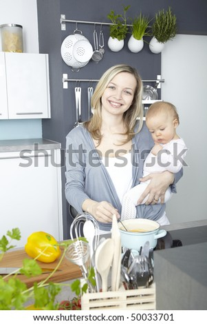 a young mother cooks with her daughter