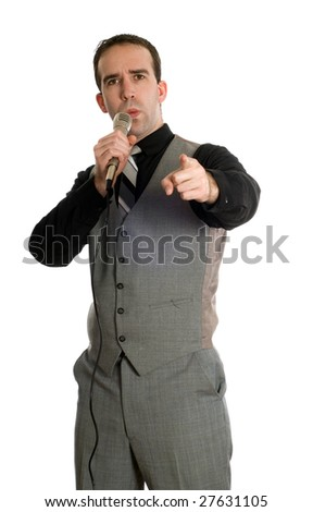 A young motivational speaker is talking into a microphone, isolated against a white background - stock photo
