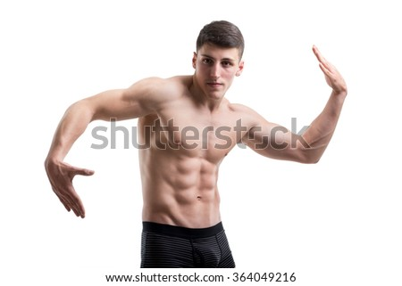 A young muscular athlete man on white - stock photo