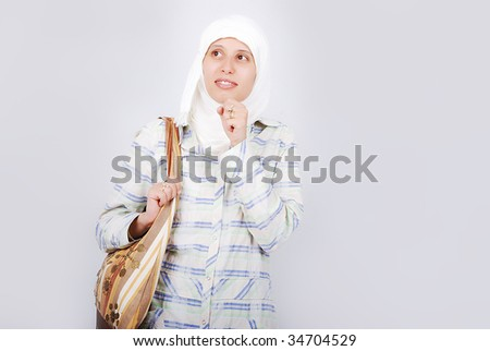 A young muslim woman in traditional clothes with a bag - stock photo