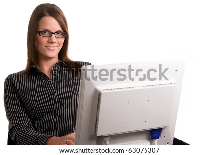 A young office worker with a computer monitor in front of her