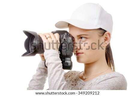 a young photographer woman with white cap - stock photo