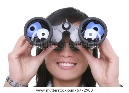 A young pretty asian business woman looking through binoculars