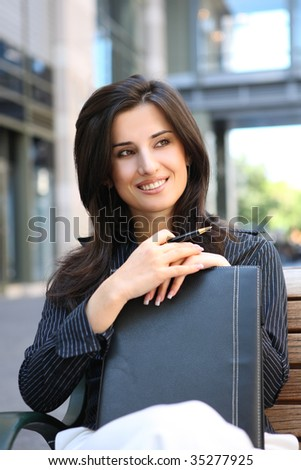 A young pretty business woman outside office building