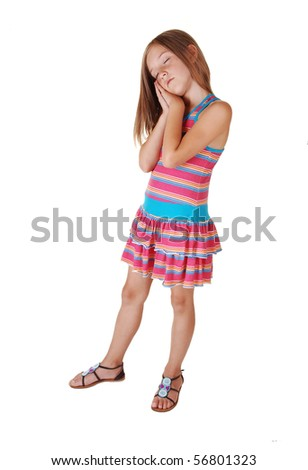 A young pretty girl standing in the studio having her hands on one chick and she sleeps as she stands, for white background.
