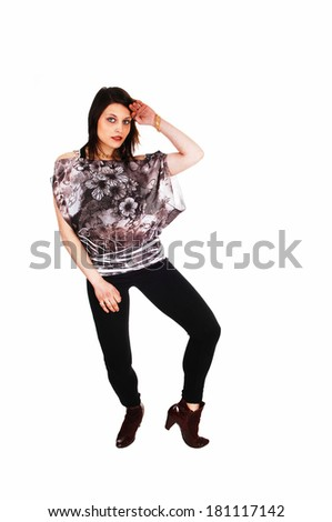 A young pretty woman in black tights and a blouse dancing for white background.