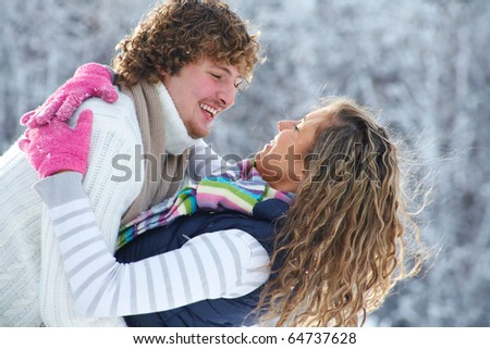 A young romance couple wants to kiss in Winter Park - stock photo