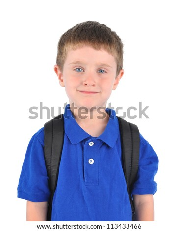 A young school boy is wearing a blue shirt on a white isolated background. He has a book bag and looks happy.