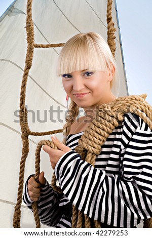A young sea cadet is ready to a travel. Spoon-bait as a earring. - stock photo