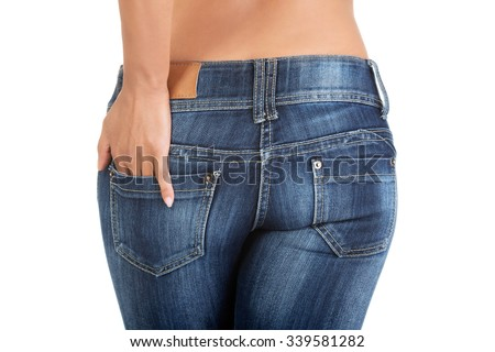 A young sexy woman is wearing blue jeans. Rear view. - stock photo