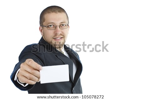 A young smiling businessman in suit wearing glasses is holding a blank business card in his right hand - isolated on white - stock photo