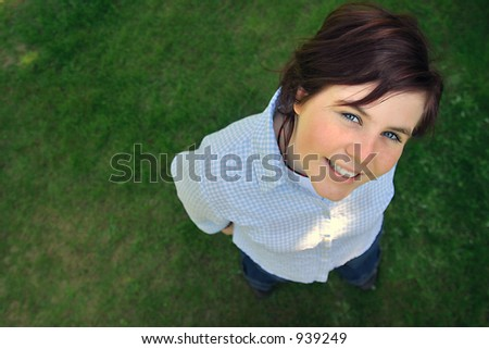 a young smiling teenager looking up. - stock photo